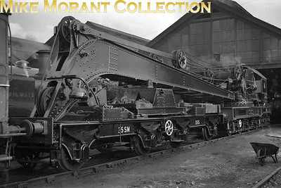 Former LSWR brakedown crane no. 35S at Eastleigh shed. The paint job, BR lined black livery with the first emblem, looks as if it has recently been applied. This crane was a 36-ton Ransomes & Rapier, supplied in 1918 to the LSWR and was allocated from new to Nine Elms, remaining there until after WW2 when it went to Fratton. In late 1946 it moved to Eastleigh where it stayed until withdrawal in January 1965. It was initially numbered No 6 at Nine Elms, renumbered to 35S soon after the SR took over and then became DS35 under BR's ownership. Image notes courtesy of the Breakdown Crane Association. [Mike Morant collection]