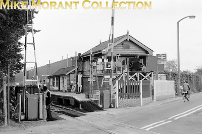 An October 1979 shot of Beddington Lane level crossing and signal box on the erstwhile single track Wimblsdon to West croydon line now subsumed by the Croydon Tramlink. [Mike Morant collection]