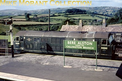 I have a feeling that this might be quite a rare image. The foreground is occupied by the BR(S) Bere Alston change for Callington branch running-in board whilst the background is nearly filled by one of the first batch of Baby Warship B-B diesel hydraulics no. D6302 still just about in its original livery. [Mike Morant collection]