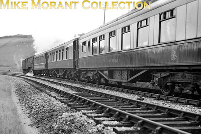 Devon Belle observation car with an unidentified Bulleid original BB on banking duties on the 1 in 36 climb from Ilfracombe to Mortehoe summit which was just before the latter station. The Pullman nearest the camera is 1st kitchen car Cynthia. [Mike Morant collection]