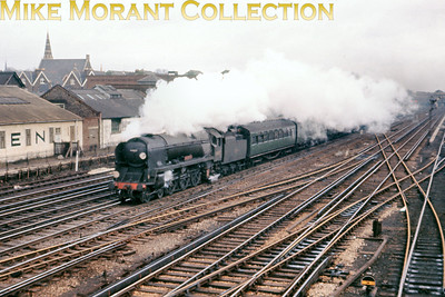 Bulleid rebuilt light pacific No. 34037 Clovelly approaches Wimbledon 'C' box on an unspecified date in 1963 with a Down Bournemouth express.