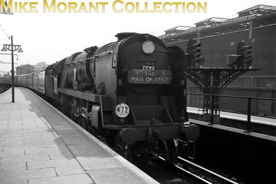 It was most unusual to find such a grubby engine in charge of a titled train and so it's possible that Bulleid rebuilt West Country pacific no. 34016 Bodmin was a last minute replacement for a failed loco and ended up in charge of the Up Man of Kent at London Bridge station on 13/9/58. [Mike Morant collection]