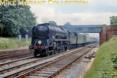There was quite a bit of steam activity at or near Hook on June 10th 1967 just a month before the cessation of steam operations in the south of England. Seen here at speed is rebuilt Bulleid light pacific No. 34021 with Down Plymouth train.