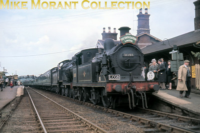 LCGB: The South Eastern Limited Rail Tour 11/6/61 SECR Wainwright 'H' class 0-4-4T no. 31308, a Tonbridge allocated engine, and Maunsell 'D1' class 4-4-0 no. 31749 from Bricklayers Arms double-headed this tour from Ashford to Robertsbridge in lively fashion apparently. We see them here after their exertions resting at Robertsbridge. The train was then split for the next tour leg to Tenterden over the former Kent and East Sussex Railway's metals.