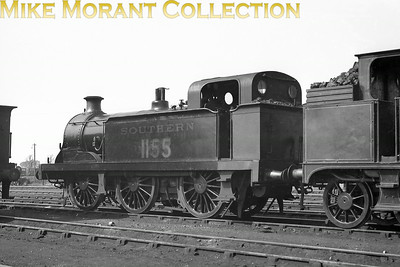 """An undated but 1930's portrait of  SECR Wainwright 'R' class 0-6-0T No. 1155 at Ashford. This loco was built in 1898 and had a relatively short working life being withdrawn from service in 1939.  Chris Knowles-Thomas's submitted notes are more comprehensive than mine: """"A 1930s portrait of one of James Stirling's SER 'R' class 0-6-0Ts with domeless boilers.  22 were built and the SECR, under Wainwright, rebuilt 13 of them with domed H class boilers as class R1.  The last R1 went in 1959 but the last R was withdrawn in 1943.  1155 has a short chimney enabling it to work on the Canterbury & Whitstable branch. The adjacent coal bunker belongs to a LCDR/SECR class R or R1 0-4-4T."""""""