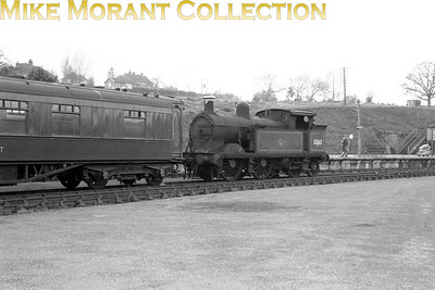 Wainwright 'H' class 0-4-4T no. 31263 together with a green liveried Pullman car that has been used as a restaurant car photographed at Robertsbridge circa 1965/6 long after 31263 had been withdrawn from service at Tonbridge shed in January 1964. This temporary home was used prior to their moves to the Bluebell Railway where 31263 still resides today whilst The 1926 Hastings gauge Pullman car will be either Barbara or Theodora - both are still on the Kent & East Sussex Railway. [Mike Morant collection]