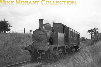 """Quite the survivor is SECR Wainwright 'P' class  0-6-0T No 1556 depicted here on Kent & East Sussex (KESR) metals circa 1938. The coach is 45' brake compo KESR No. 3, ex SR 6413 formerly LSWR acquired by the KESR in 1932. No. 1556  didn't acquire its BR No. 31556 until March 1950 during its twelve year spell at brighton mpd which ended in 1961. That was followed by sale to the """"Pride of Sussex"""" flour mill at Robertsbridge and eventual preservation on the latter day KESR heritage railway."""