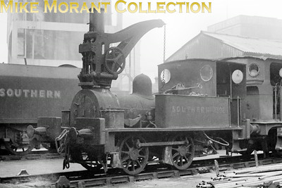 The South Eastern Railway ordered two 0-4-0 crane tanks from Neilson & Co. Which were delivered in 1881 for use at the company's Ashford works in Kent. This Neilson works number 2686 which went on to experience a varied career including a long spell at Lancing carriage works in SR days. In 1938 and renumbered 1302S this 0-4-0CT was allocated to Stewarts Lane shed where it was primarily used at the CWS milk depot. 1302 survived the war and nationalisation only to be withdrawn in July 1949 without acquiring BR branding. This picture was taken on an unknown date at Stewarts Lane mpd and the tender in the background suggests that this was sometime after the war.