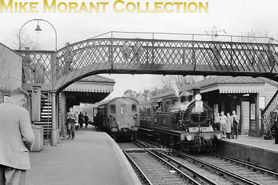 """SCTS: The South Londoner 20/4/58 SECR Wainwright 'H' class 0-4-4T No. 31521 at Mitcham station with regular passenger fare in the form of 2-EPB electric unit No. 5729 alongside. This is looking towards Mitcham and the EMU is working with the headcode still in place at the rear which wasn't unusual on this line. 31521 was allocated to Tunbridge Wells West mpd when this shot was taken and the tour which had originated at Beckenham Junction included West Croydon to Merton Park followed by a jaunt along the stub of line to Merton Abbey. As I've received a second message about the headcode at the rear it's repeated here: """"the 2-EPBs in the rear red oil lamp days never changed the headcodes at their rears on Central Division's No.2 shuttles.   This practice ceased when the oil lamps were replaced by the red blinds in the headcode apertures."""" [Notes submiited by Geoff Smith and Colin Withey]"""