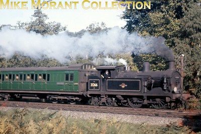 Not the crispest of images but just about worthy of inclusion. Wainright 'H' class 0-4-4T no. 31266 in charge of a green liveried SECR birdcage set at Langton Green in September 1959. 31266 was a Tunbridge Wells West allocated engine when this shot was taken and would remain at TWW until withdrawal in September 1960. The birdcage set no. is 65? whilst the last digit of the visible coach number is '4'. [Mike Morant collection]