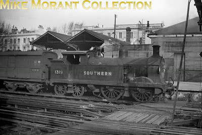 SECR Wainwright 'H' class 0-4-4T no. 1319 is depicted here at Addison Road station in Kensington which would later be known as Olympia. This shot was taken around 1947/48 when 1319 was allocated to Stewarts Lane mpd. 31319 moved around quite a bit after that and would eventually end its service at Tonbridge shed in January 1960.