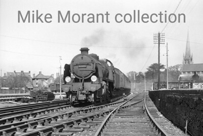 A nice shot with the goods yard on the left and the church steeple on the right with Maunsell 'N' class mogul no. 31401 arriving with a Reading to Guildford train approaching Wokingham station. There is no shed plate on the smokebox door and i suspect that this was taken during the dying days of steam on the Redhill - Reading line when 31401 was allocated to Guildford mpd.