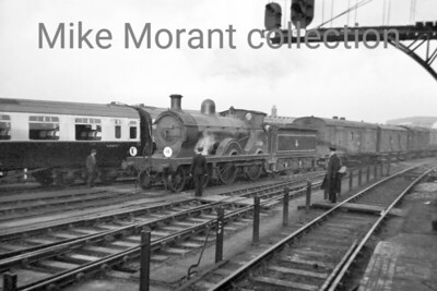 For a change with these negatives that I took when I was a kid this shot can be dated to the Christmas holiday period in 1955. I was immensely surprised to see Wainwright 'D' class 4-4-0 no. 31488 on a parcels service at Clapham Junction and I've forever after been surprised at just how good this shot is because it was misty (thanks go to digital technology for cutting through that obstacle) and quite late in the sfternoon as can be seen from the length of the shadows. What I hadn't realised until more recent times was that it wasn't that unusual for a 'D' to be seen at Clapham Junction as many spent their later years at Guildford shed as was the case with 31488 when this shot was taken although the end was nigh for this loco as withdrawal, at Guildford mpd, came only two months after this shot was taken. Photo taken by Mike Morant