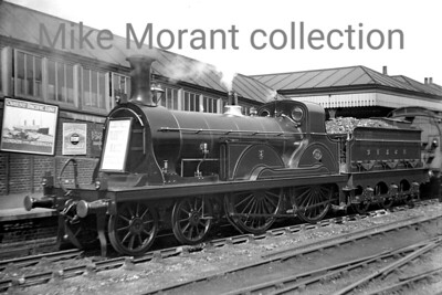 Pristine SECR 'F' class 4-4-0 no. 133 awaits departure from East Croydon's Oxted line platform with a Folkestone Races Special (as stated on the rudientary headboard) in 1906. No. 133 was a Stirling designed loco for the SER which was built at Ashford works in 1892 but would be rebuilt as an F1 by Wianwright in 1907 only a year after this shot was taken. Withdrawal by the Southern came in 1933. [Mike Morant collection]