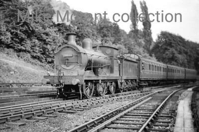 Wainwright 'C' class 0-6-0 no. 31037 reverses a birdcage set southwards from Sevenoaks station in a shunting movement. 31037 has a 74D Tonbridge shed plate which narrows the timescale for this shot to somewhere between 7/52 and 1/54. [Mike Morant collection]