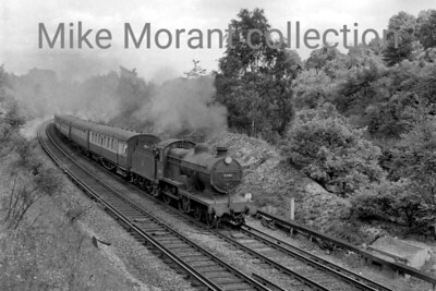 Maunsell L1 class 4-4-0 no. 31783 in charge of an inter-regional excursion bound for Eastbourne and/or Hastings is depicted here at Hooley on the Quarry Line on 15/7/56. 31783 was a Bricklayers Arms engine at the time and the train's stock is entirely of eastern region origin which suggestd that it had arrived on Souther metals via th East London Line and 31783 had taken over the haulage duties at New Cross Gate. [Mike Morant collection]