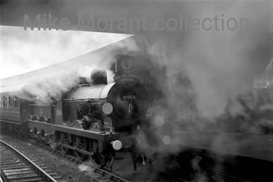 BR and/or G. R. Lockie: The Kentish Heights Special 10/11/57 It was intended that GWR no. 3440 City of Truro would start this tour and run as far as East Croydon where 31064 would take over the haulage duties but she failed and no one is sure what actually happened next. However, what is known is that Wainwright/ Stirling O1 class 0-6-0 no. 31064, splendidly turned out as ever by the Stewarts Lane cleaners, arrived at Clapham Junction with the special as depicted here in the stygian gloom underneath the footbridge.  The sixbellsjunction web site doesn't state or, indeed, know, who chartered this special. I think it's a G. R. Lockie effort with ramblers in mind based on the fact that it went via Crystal Palace, his nearest station to home I think, and actually stopped there.