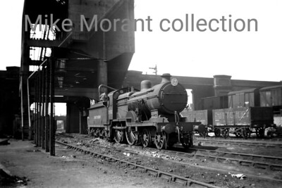 SECR Maunsell D1 class 4-4-0 with SOUTHERN on its tender takes on water at Stewarts Lane depot on May 1st, 1950. 31502 was a Faversham engine at the time and would be withdrawn from service there in February 1951.