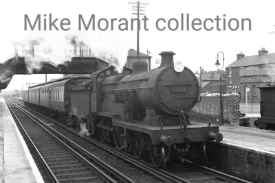 SECR Maunsell 'E1' class 4-4-0 no. 31497 at Sittingbourne station on a dull 8th June 1959. No. 31497 was rebuilt from a Wainwright 'E' class by Beyer Peacock in 1920 and was withdrawn in 1960 whilst allocated to Bricklayers Arms.