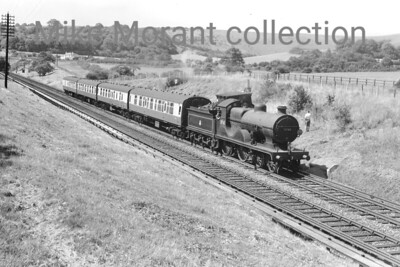 Maunsell/Wainwright 'L' class 4-4-0 no. 31760 in charge of the 10.46 Brighton - Chester service at Hassocks in July 1957. This stock would be coupled at Redhill to the longer portion of this service originating at Ramsgate and depart westwards towards Guildford, Reading, Birmingham end, eventually, Birkenhead. The 'L' class was known as 'Germans' because some were built by Borsig of Berlin but this example was one of the batch built by Beyer Peacock in August 1914. [Mike Morant collection]