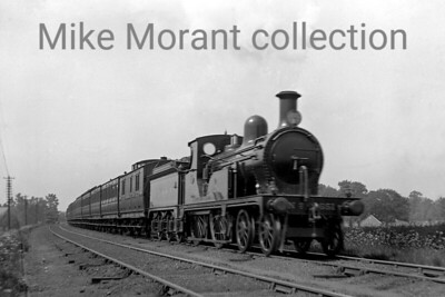 SECR no. 651 was a Kirtley designed M3 class of  4-4-0 built for the LCDR and was originally numbered 192. This shot was taken at Dulwich, later West Dulwich, in 1904.. [Mike Morant collection]