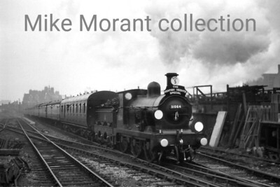 BR and/or G. R. Lockie: The Kentish Heights Special 10/11/57 It was intended that GWR no. 3440 City of Truro would start this tour and run as far as East Croydon where 31064 would take over the haulage duties but she failed and no one is sure what actually happened next. However, what is known is that Wainwright/ Stirling O1 class 0-6-0 no. 31064, splendidly turned out as ever by the Stewarts Lane cleaners, arrived at Clapham Junction with the special as depicted here passing 'B' Box on the climb from Latchmere.  The sixbellsjunction web site doesn't state or, indeed, know, who chartered this special. I think it's a G. R. Lockie effort with ramblers in mind based on the fact that it went via Crystal Palace, his nearest station to home I think, and actually stopped there.