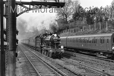 "SLS: London, Chatham & Dover Rail Tour 19/5/57 Maunsell D1 class 4-4-0 no. 31545 was exquisitely turned out for this tour and is depicted here on the outward run from Victoria to Shepherd's Well. The supplied data states that this was taken at Shortlands but I have my doubts about the location and a viewer has contacted me to confirm that together with the suggestion that the location is more akin to Bickley which has been confirmed by David Woodcock: ""Taken from the west end of the (then) up island platform at Bickley. The presence of a stabled 4-SUB (almost certainly a pair) in the downside siding on the right confirms this as this was the only place on this stretch were stock could be (and regularly was) stabled."""