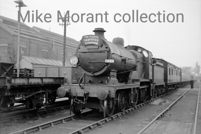 REC: The North Hampshire Downsman 22/5/60 Southern Railway Maunsell rebuild of a Wainwright designed 'E' class 4-4-0, 'E1' class no. 31067 is depicted here at Eastleigh works parked whilst the tour participants visited the works and shed areas. 31067 hauled this tour throughout but needed the unsceduled banking assiatance of a GWR pannier tank on the steep ascent from the Southern to the Western at Reading. 31067 was allocated to Stewarts Lane when this shot was taken and would be withdrawn from there in November 1961.