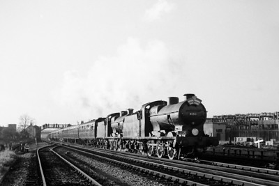 LCGB: The Hayling Farewell tour 3/11/63 Maunsell 'Q' class 0-6-0's nos. 30531 and 30543 are depicted leaving Havant for Chichester. David Woodcock adds that the footbridge in the background is at New Lane level crossing whilst the gradient post on the right is alongside the Portsmouth Direct line. Both engines would be withdrawn in 1964. [Mike Morant collection]
