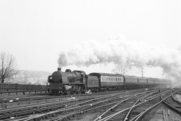 Good shots of the Maunsell 'U1' moguls rarely arrive here and two turned up in as many weeks. Here we see a storming runpast at Purley on 11/4/54 with no. 31906 in charge of the Down Newhaven Boat train relief which I might well have seen myself some 15 mintes previously as it passed under the footbridge at Norbury. The main train was always hauled by a Bulleid electric loco but the relief was awaited with palpable anticipation by the spotters on that bridge as one never kmew what would turn up. On one occasion it was a U1 piloting a Bulleid pacific and what a sight that was.