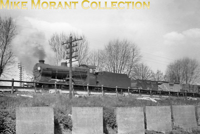 Maunsell 'Q' class 0-6-0 no. 30547. The concrete slabs are tank traps which were embedded in order to inhibit the invading Wehrmacht's advance towards London in the event of an invasion. The location is believed to be near Purley. [Mike Morant collection]