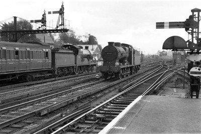 Locomotives aside, this is an evocative panorama of the country end of Redhill station in steam days featuring Maunsell 'Q' class 0-6-0 no. 30538, Wainwright 'L' class 4-4-0 no. 31762 awaiting departure for Tonbridge and some nice SECR birdcage stock as a bonus for the viewers.