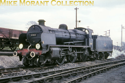 Maunsell 'N' class mogul no. 31411 at Salisbury mpd on 3/4/66. 31411 in tandem with 'U' class no. 31639 had brought the Wilts and Hants railtour from Waterloo via an invredibly circuitous route but this would be 31411's last involvement in this tour.
