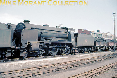 Maunsell Schools class 4-4-0 30911 Dover stored, minus nameplates and pending scrapping, in the sidings at the side of Hove station on May 5th 1963.