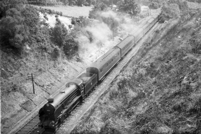 An unusual view of former Southern Railway Maunsell 'Schools' class 4-4-0 no. 30909 St. Paul's which is about to enter Strawberry Hill tunnel in the up direction ( between Frant and Grove Junction ) during August 1951. St. Paul's was allocated to St. Leonards at the time and would later move to Stewarts Lane, Nine Elms and finally Guildford whence withdrawal qould come in February 1962.
