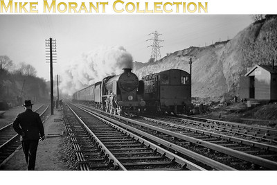 This splendid shot is more about appearance than the locomotives which are a Maunsell Schools 4-4-0 and a Bulleid 350hp diesel shunter at Knockholt. This can be dated to the first half of 1953 when the cutting was widened here to provide chalk infill for the repair of the Kent Coast line washed away by the January floods of that year. [Mike Morant collection]