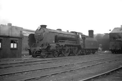 Maunsell 'Schools' class 4-4-0 no. 30914 Eastbourne in BR lined black livery poses outside Bricklayers Arms mpd on 27/6/53.