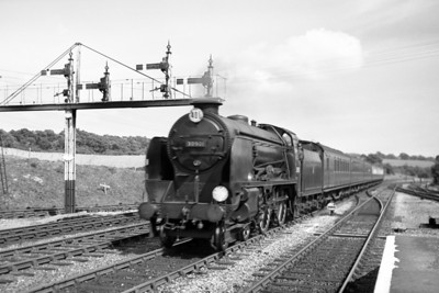 Former Southern Railway Maunsell 'Schools' class 4-4-0 no. 30901 Winchester speeds northwards through Crowhurst station in August 1951. Winchester was allocated to St. Leonards at the time and would remain there until transfer to Brighton in Mrach 1958 but withdrawal symptoms would set in during The Great Cull of many superb locomotive classes in December 1962.