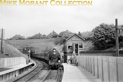Maunsell 'Schools' class 4-4-0 no. 30910 Merchant Taylors eases past Bopeep Junction signal box at West St. Leonards station on 7/6/58. One id always grateful for a dated negative but I wonder if either the date is wrong or my allocation notes are but, unfortunately, the engine is too distant to read the shed plate. 30910 would move to the Western Section in March 1959 and withdrawal would follow at Nine Elms mpd in November 1961. [Mike Morant collection]