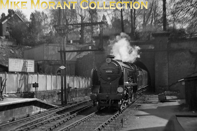 Maunsell Schools class 4-4-0 no. 30906 Sherborne bursts out of the tunnel and enters Tunbridge Wells Central station whilst i9n charge of a Hastings to London Bridge service in May 1951. 30906 was a St. Leonards engine at the time and would remain there until reallocation to Nine Elms in March 1957. Withdrawal would come at Brighton in December 1962 as part of The Great Cull. [Mike Morant collection]
