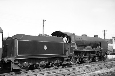 Former Southern Railway Maunsell 'Schools' class 4-4-0 no. 30910 Merchant Taylors, in charge of a Hastings service, departs southwards from Crowhurst station in August 1951. Merchant Taylors was allocated to St. Leonards at the time and would be reallocated several times before withdrawal at Nine Elms mpd in November 1961.