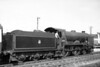 Former Southern Railway Maunsell 'Schools' class 4-4-0 no. 30910 <i>Merchant Taylors</i>, in charge of a Hastings service, departs southwards from Crowhurst station in August 1951. <i>Merchant Taylors</i> was allocated to St. Leonards at the time and would be reallocated several times before withdrawal at Nine Elms mpd in November 1961.