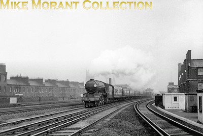 The Southern's shortage of express motive power when all the Bulleid pacifics were temporaily withdrawn in May 1953 following a cracked axle incident led to several Gresley V2 class prairies moving to Nine Elms mpd to cover some of their duties. No. 60916, on loan from New England shed, is depicted here in charge of a Bournemouth express on the approach to Vauxhall station.