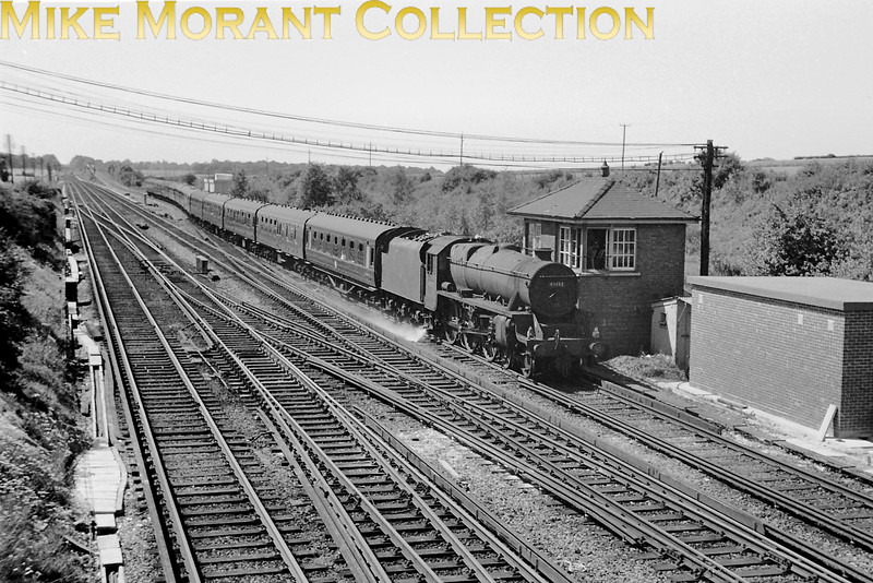 Stanier 'Black 5' 4-6-0 no. 45132, a Shrewsbury allocated engine, in charge of a nortbounnd inter-regional express passes Worting Junction signal box apparently in 1966. which could well be correct as the third rail is evident. [Mike Morant collection]