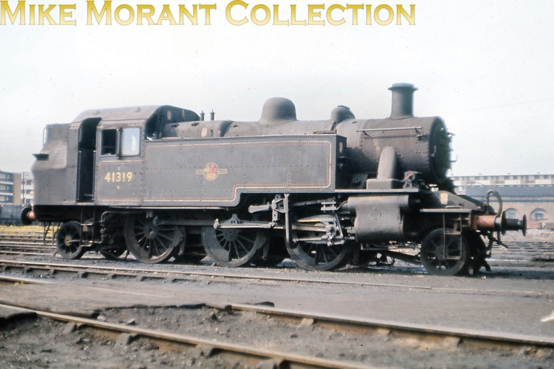 Ivatt 2MT 'Mickey Mouse' 2-6-2T no. 41319 at Nine Elms mpd in May 1967. 41319 been a Southern allocated engine from new in June 1952 and had come to Nine Elms as late as March 1967 remaining there until the end of steam in July. [Slide taken by Mike Morant]