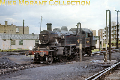 Ivatt 2MT 'Mickey Mouse' 2-6-2T no. 41319 slakes its thirst at Nine Elms shed.