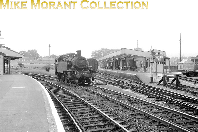 It's a poor negative but is here to demonstrate the odd traffic arrangements for 'Up' services that stopped at Dorchester South station in steam days. This is Ivatt 'Mickey Mouse 2-6-2T no. 41324 moving past the 'Up' branch that required stopping services to reverse into the platform as shown here. [Mike Morant collection]