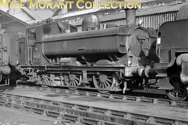 Collett 5700 class 0-6-0PT no. 4692 bathed in sunlight at Nine Elms mpd in 1961. [Mike Morant collection]