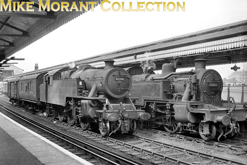 Fairburn 2-6-4T's were a common sight on SR metals through the 50's and into the 60's but it was unusual to see one on South Western metals as depicted here where we see no. 42118 alongside Fowler 3MT 2-6-2T no. 40026 between platforms 2 & 3 on the Windsor side of Clapham Junction with both locos pointing northwards. In fact no. 42118 wasn't one of the Southern contingent but was a visiting and 1A Willesden engine whilst 40026 bears a 14E Kentish Town shed plate which narrows the period when this shot was taken to sometime between April and December 1962. Note that 'targets' rather than 'totems' were still the order of the day here. [Mike Morant collection]