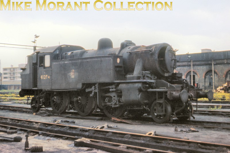 Ivatt 2MT 'Mickey Mouse' 2-6-2T no. 41284 looking much the worse for wear at Nine Elms mpd in May 1967. 41284 hadn't arrived on the Southern until June 1961 and had come to Nine Elms in October 1966 but didn't see out the end of SR steam being withdrawn in March 1967. [Slide taken by Mike Morant]